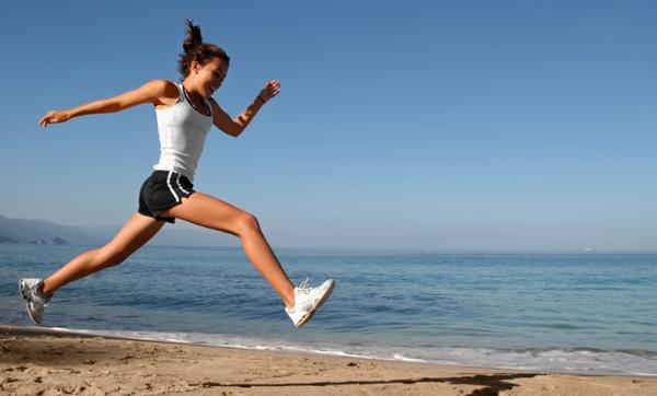 Woman running on San Diego beach