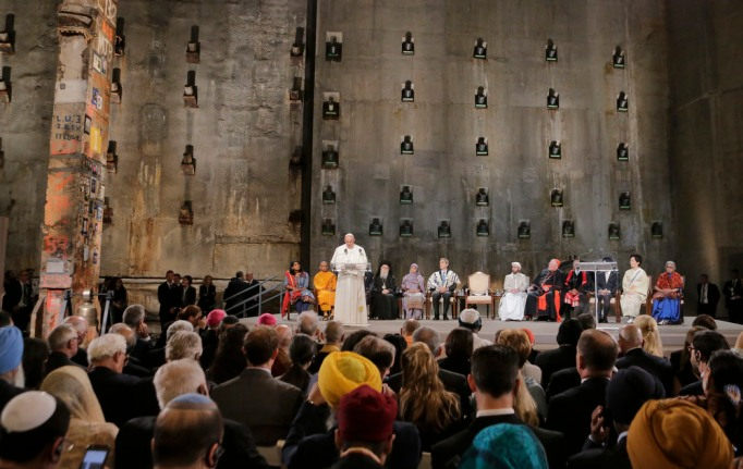Pope Francis speaks during a ceremony inside the 9/11 Memorial