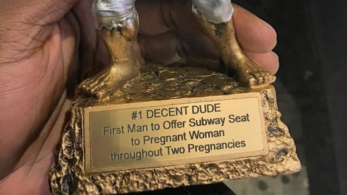 Pregnant Woman Awards a Trophy to