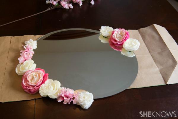 Flowers on edge of mirror