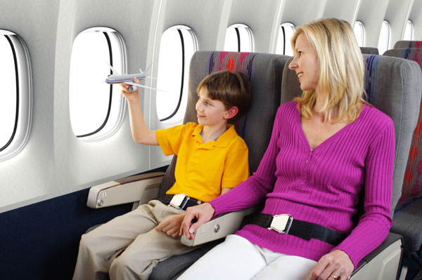 Mom and child flying on airplane