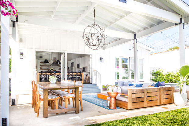 Home with an outdoor living and dining room