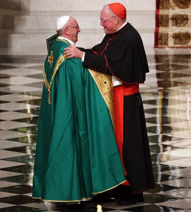 Pope Francis embraces Cardinal Timothy Dolan