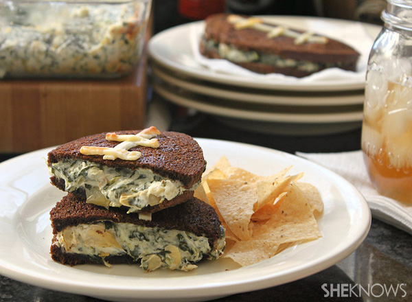 Football shaped grilled cheese sandwiches stuffed with spinach artichoke dip