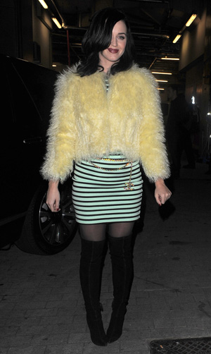 Katy Perry wearing fuzzy yellow coat