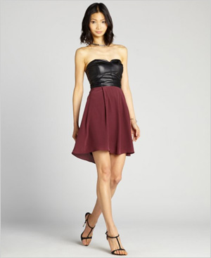 Shop the look: Wyatt Burgundy and Black Leather Strapless Sweetheart Dress (bluefly.com, $159)