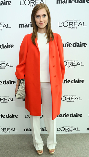 Allison Williams wearing orange coat