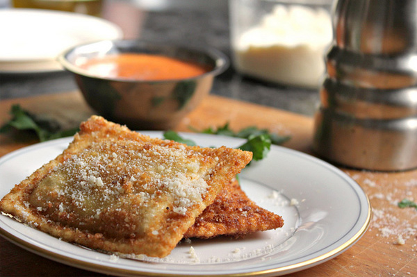 Fried lobster ravioli with a red pepper cream sauce