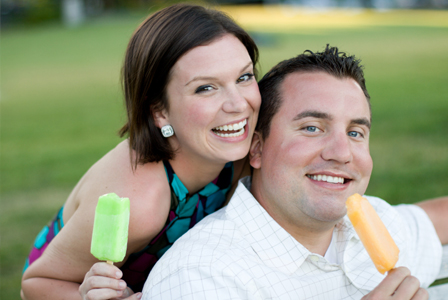 Friends having ice pops at party