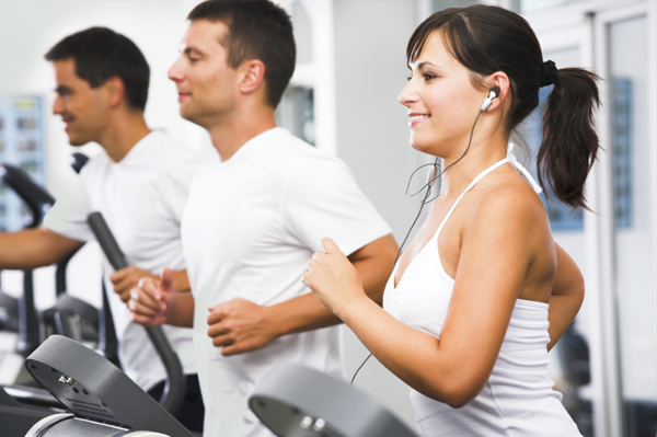 Woman exercising at gym listening to music