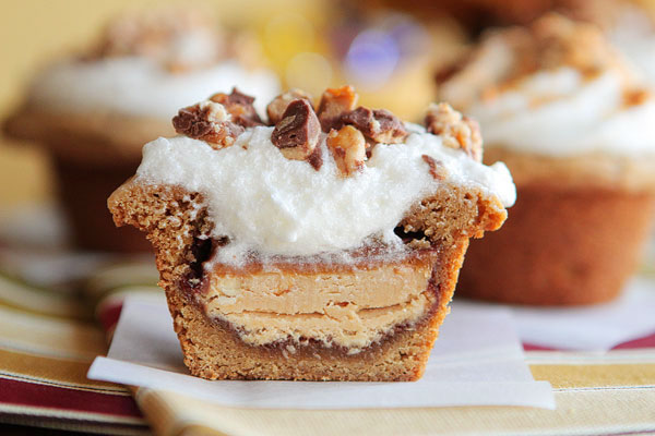 Frosted candy bar-stuffed cookie cups