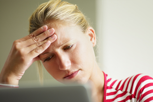 Frustrated Woman with Computer