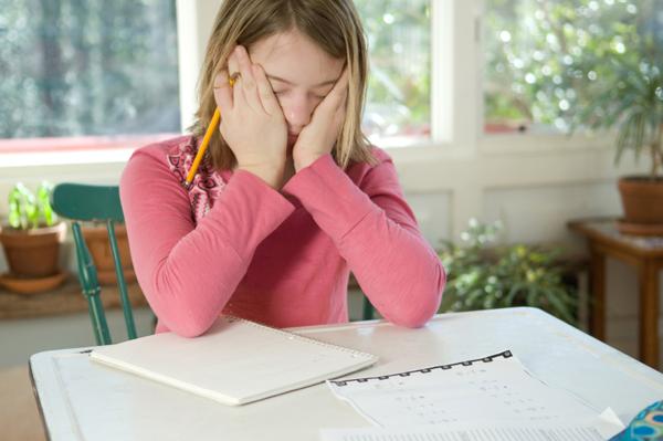 frustrated girl doing homework