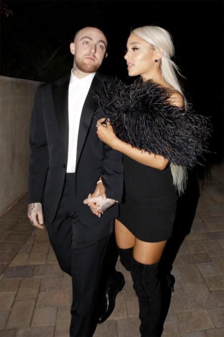 Mac Miller and singer Ariana Grande are seen attending an Oscar part