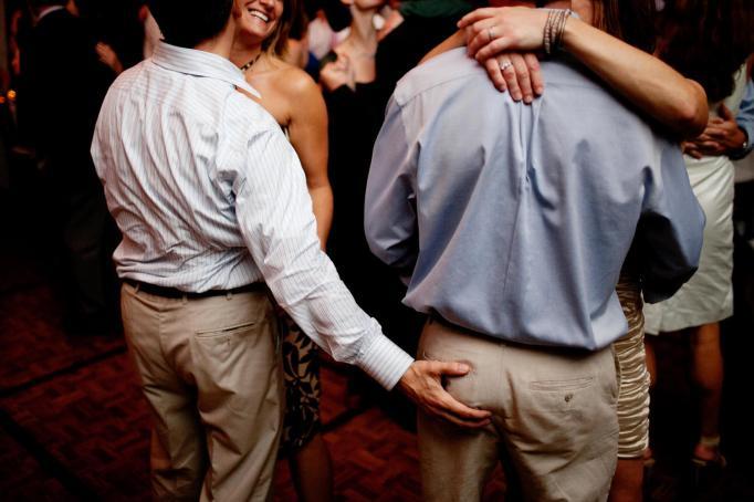 Butt grab wedding photo