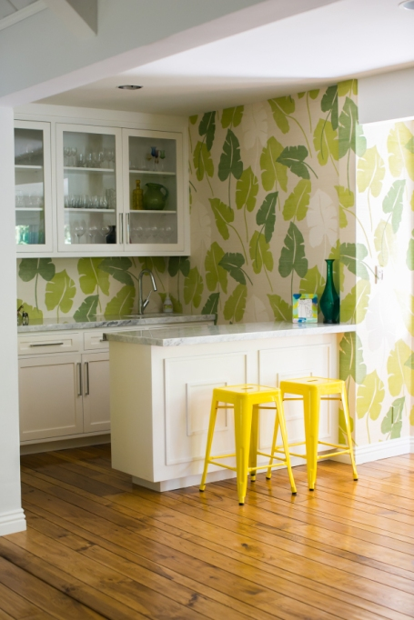 yellow chairs and green wallpaper kitchen