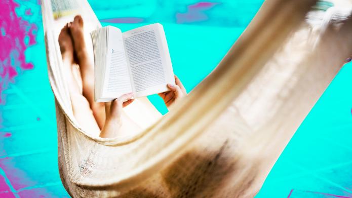 Woman in hammock reading