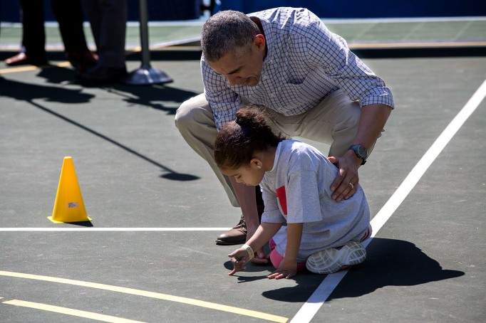 Obama talks to little girl at basketball clinic