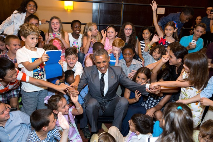 Obama surrounded by children