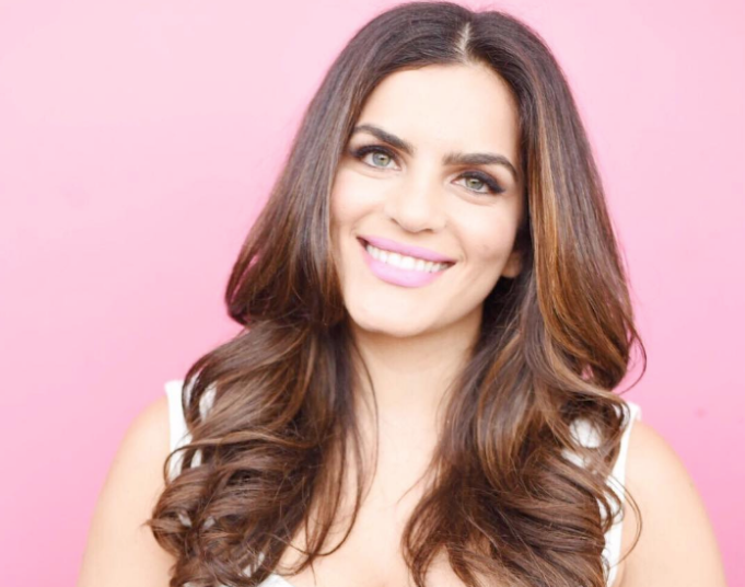 Jessica Naziri headshot pink background