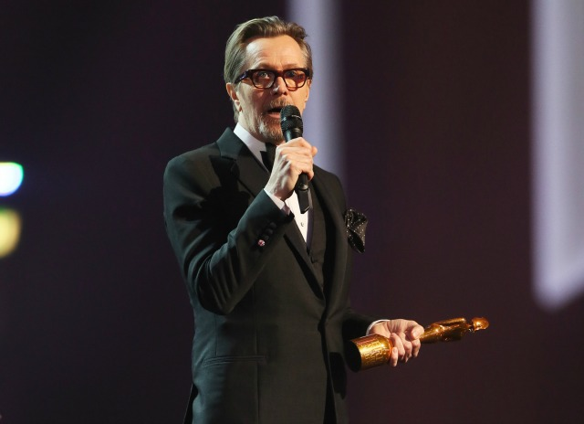 Gary Oldman accepts Brit award on behalf of David Bowie