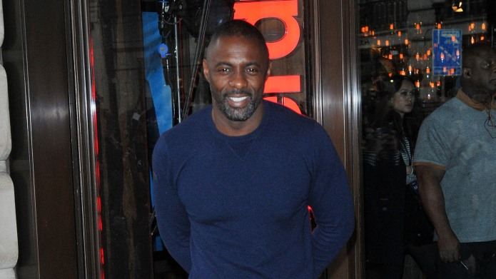 Idris Elba attends a photocall to