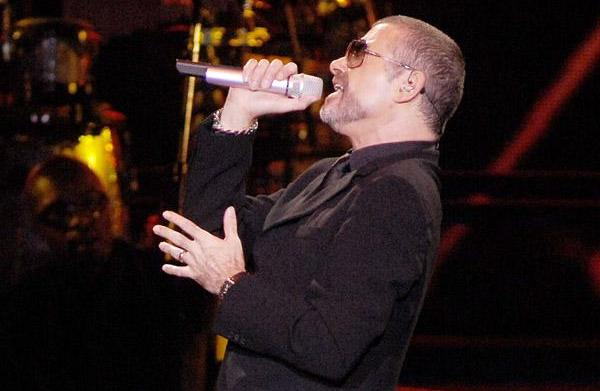 George Michael is slowly improving say