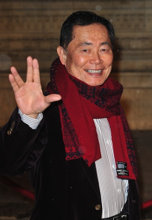 George Takei gives the Vulcan Salute to fans.