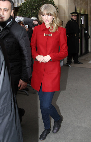 Taylor Swift wearing red coat
