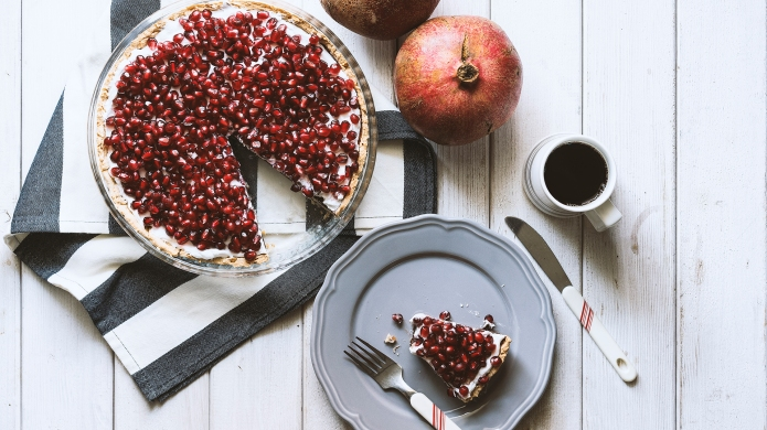 Homemade tart, topped with fresh pomegranate
