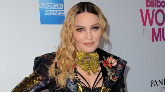 Madonna Adopts 4-Year-Old Sisters