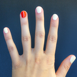 White finger nails, with an orange ring fingertip