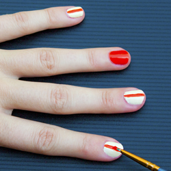 Creating the orange stripe on the white finger nails