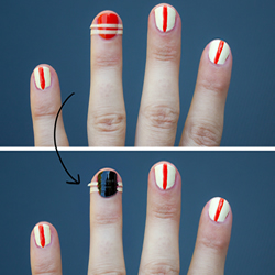 Painting the ring finger nail with black nail polish
