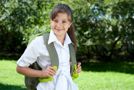 Girl with green backpack