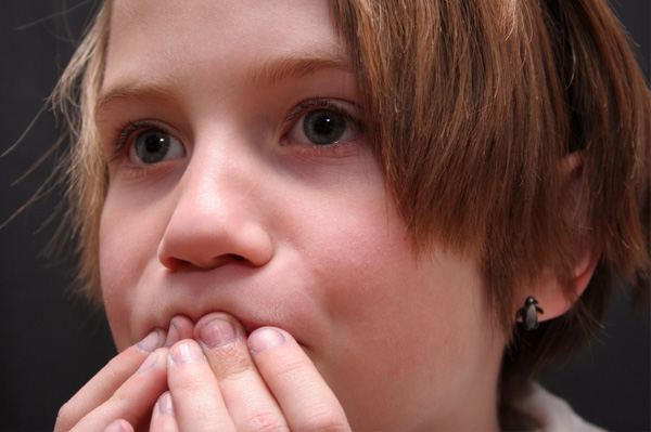 Girl covering mouth