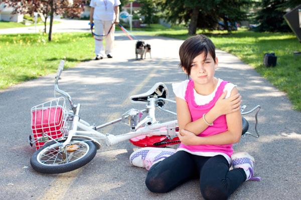 Girl fallen off bike