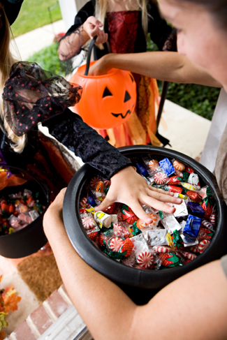 Girl grabbing halloween candy