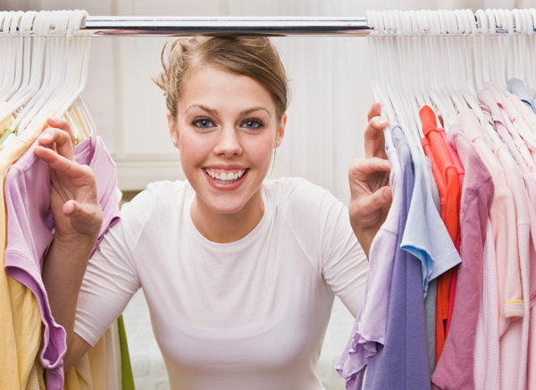 woman standing in organized closet