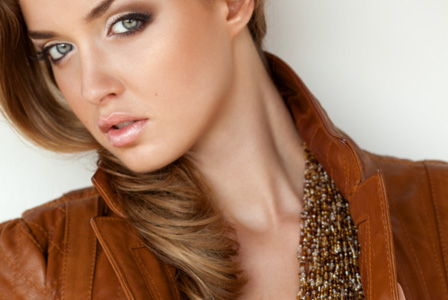 Girl in stylish brown leather jacket