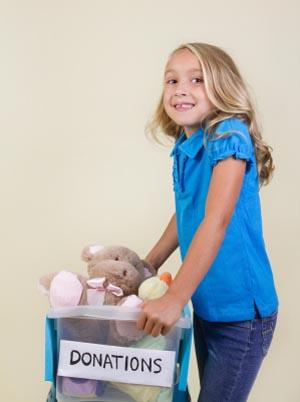 girl donating toys