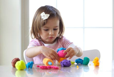 preschooler playing with play dough