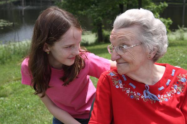 Girl spending time with senior