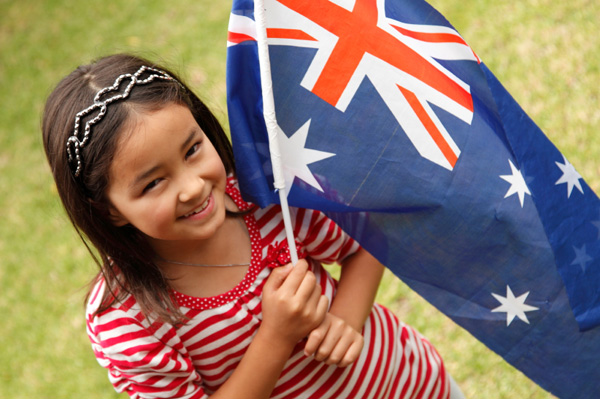Little girl holding Australian flag