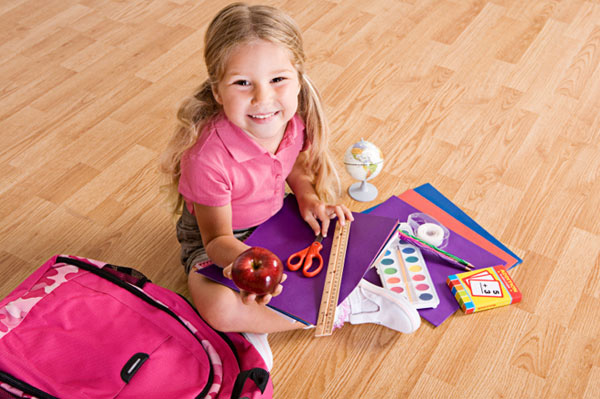 Girl with back to school supplies