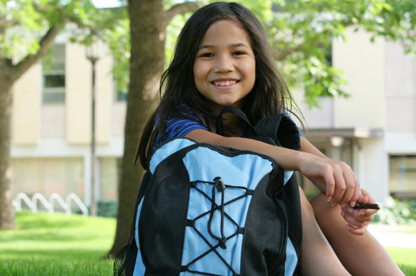 girl in front of school