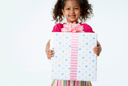 Girl with birthday present | Sheknows.com