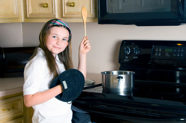 Girl with Oven Mitt Cooking