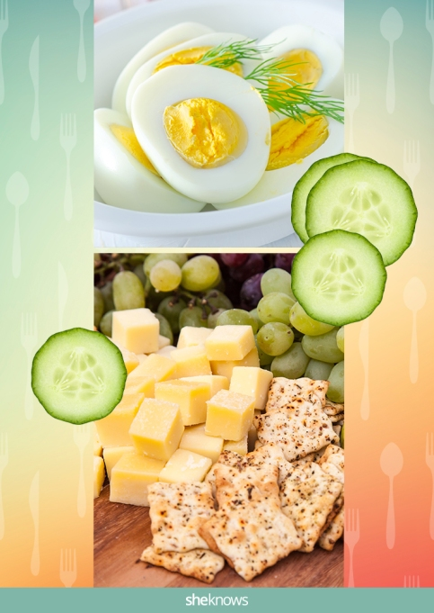 Hard-boiled eggs with a side of cucumber slices, cheese cubes and crackers