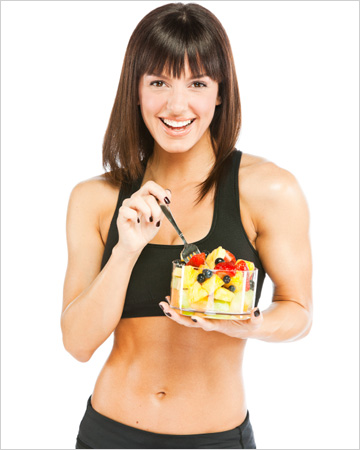 Athlete eating fruit salad
